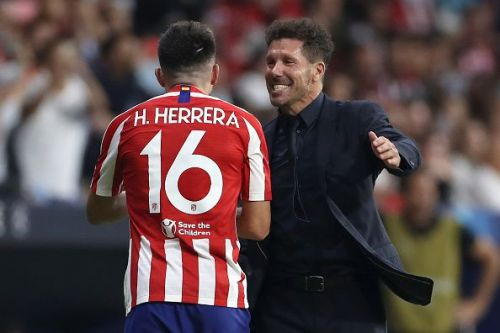 Atletico Madrid's Hector Herrera and Diego Simeone celebrate their last gasp equaliser!