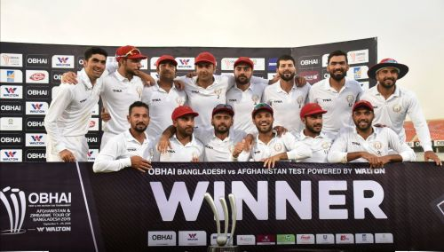 Afghanistan players with the winners' trophy.