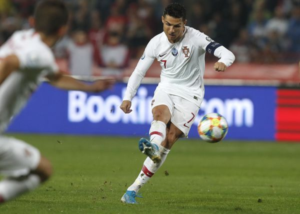 Cristiano Ronaldo scores from the spot against Lithuania in Vilnius
