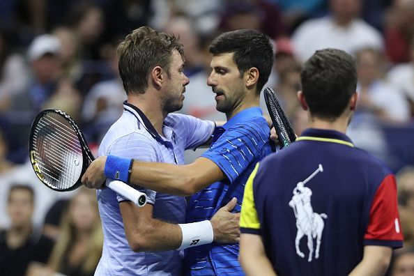 The 2016 US Open finalists meet at the net following Djokovic