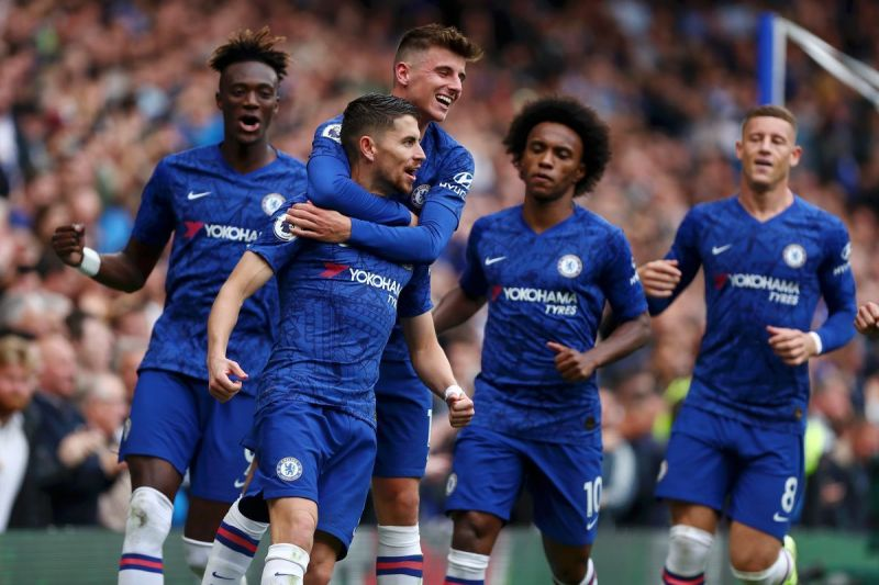 Chelsea players celebrating Jorginho