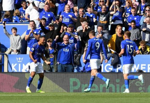 Leicester City players celebrate a goal.