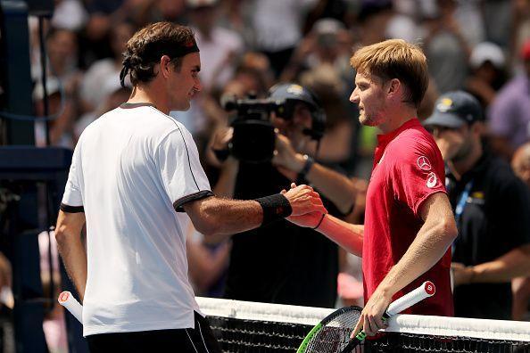 Roger Federer (L) and David Goffin