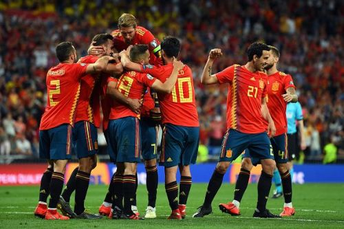 Spanish players celebrate during the previous clash between these two sides