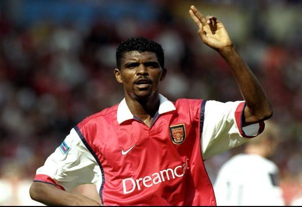 Kanu in action for the Gunners.