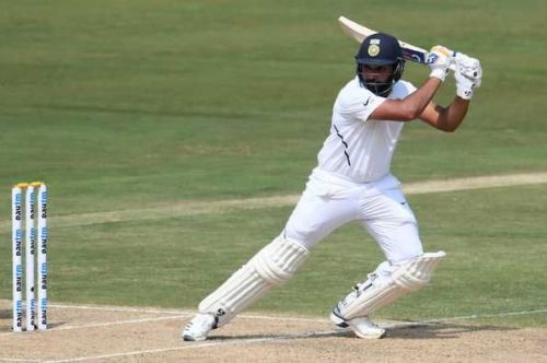Rohit Sharma cuts a short delivery behind point.