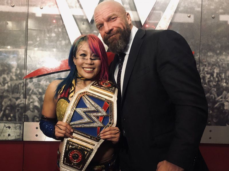 Asuka with Triple H