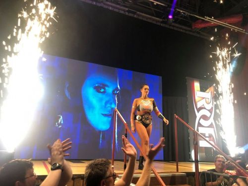 Woman of Honor Champion Kelly Klein making her entrance with pyro!