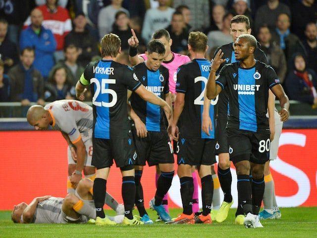 Club Brugge (in blue and black)