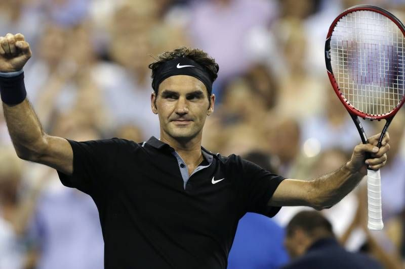 Federer exults after beating Bautista Agut in the fourth round of the 2014 US Open