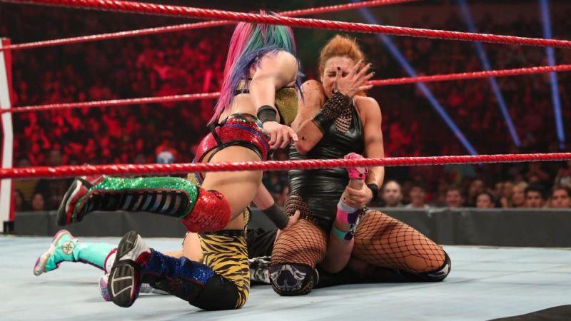 Asuka spitting green mist on Becky Lynch