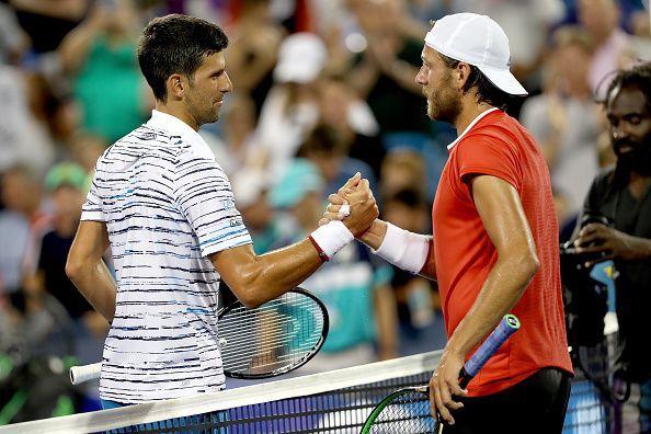 Novak Djokovic (L) and Lucas Pouille