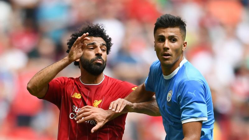 Rodri tussles with Mohamed Salah - cropped