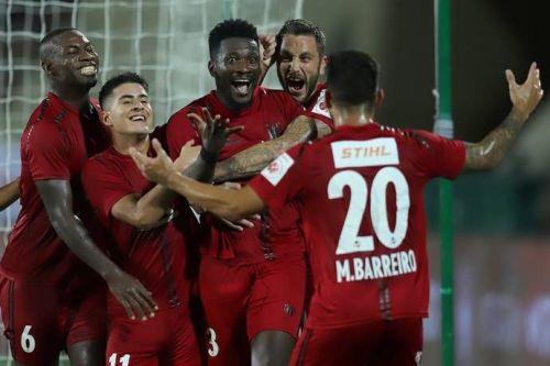 NorthEast United FC players celebrate after scoring the winning goal against Odhisha FC.