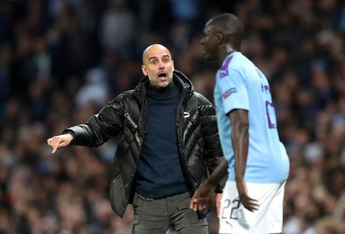 Manchester City's manager Pep Guardiola remonstrating with Benjamin Mendy