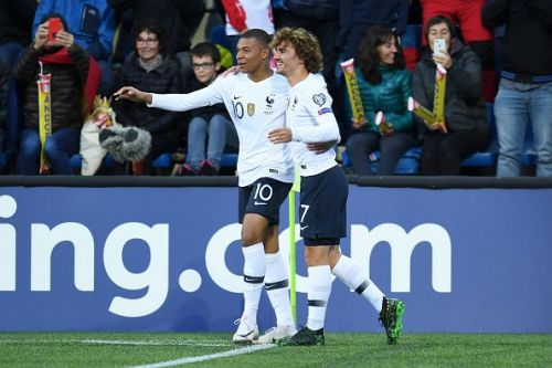 French players, Kylian Mbappe and Antoine Griezmann celebrate a goal