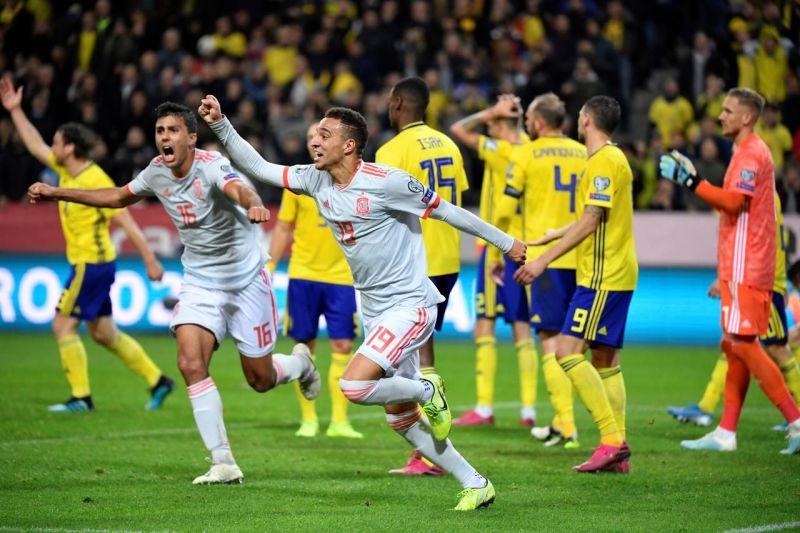 Rodrigo wheels away to celebrate his stoppage-time equalizer, granting Spain
