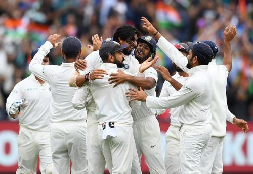 The Indian test cricket team celebrating a wicket