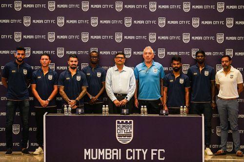 L-R: Pratik Chaudhari, Amine Chermiti, Paulo Machado, Modou Sougou, Bimal Parekh (Co-Owner), Jorge Costa (Head Coach), Mohammed Rafique, Rowllin Borges, Indranil Das Blah (CEO).