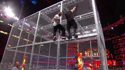 Shane McMahon and Kevin Owens hang from the side of the Cell in 2017.