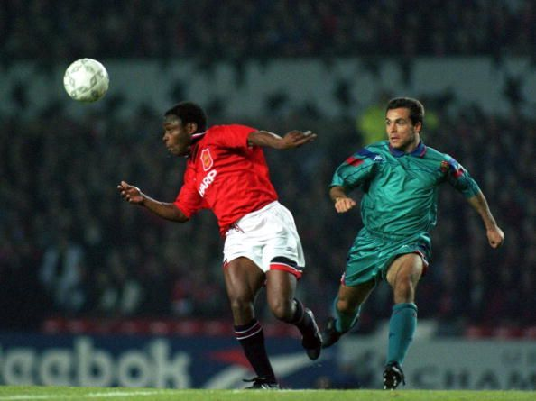 Paul Parker (l) in action for Manchester United