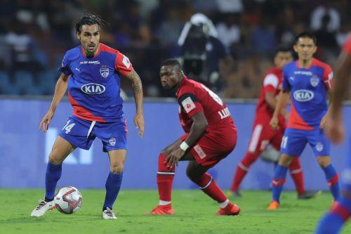 Bengaluru FC's Dimas Delgado and NorthEast United FC's Jose Leudo in action.