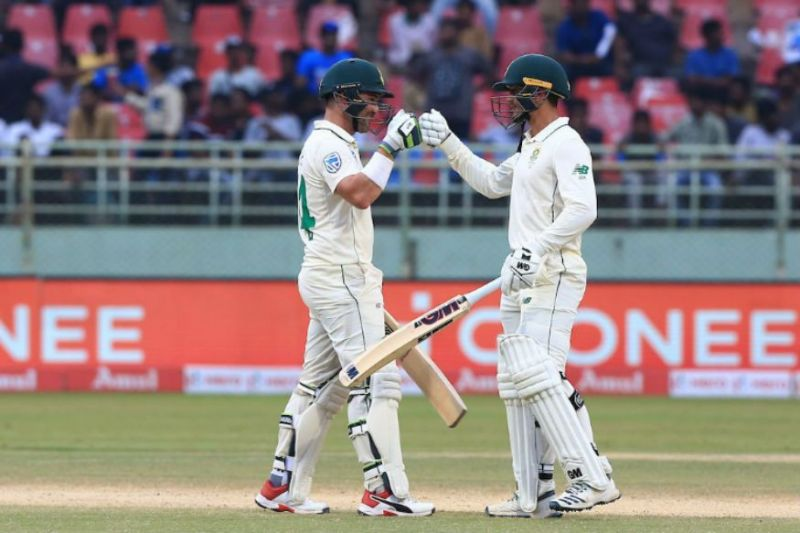 Dean Elgar punches gloves with Quinton de Kock after completing a valiant 100-run partnership.