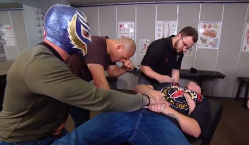 Rey Mysterio and Cain Velasquez with Mysterio's son Dominick