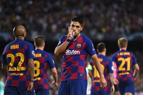 Luis Suarez scored twice to give Barcelona their first UCL victory of the season