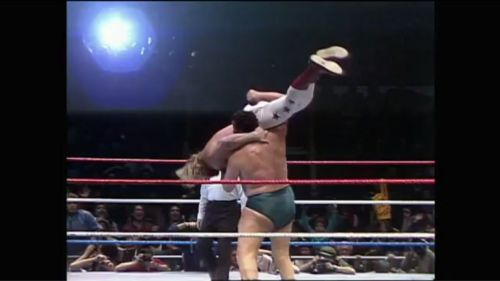 Andre hefts fellow big man Big John Studd in a body slam challenge match.