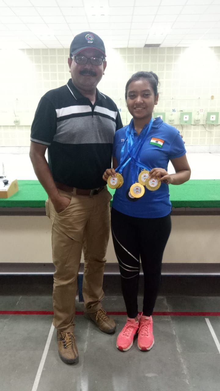Ayushi Podder with coach father