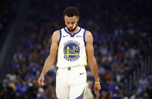 Stephen Curry suffered a broken hand (left) against the Phoenix Suns