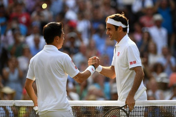 Federer beat Nishikori to become the first player to win 100 matches at Wimbledon