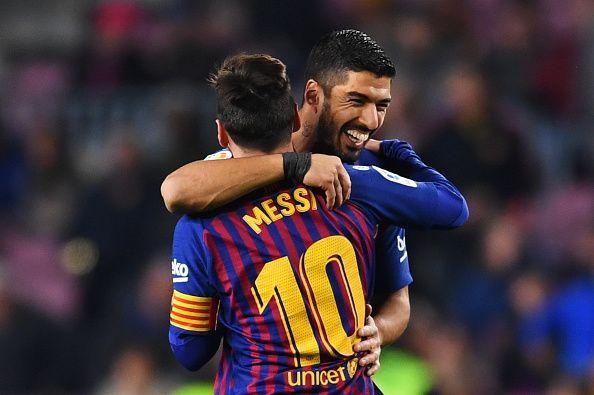 Luis Suarez with Lionel Messi.