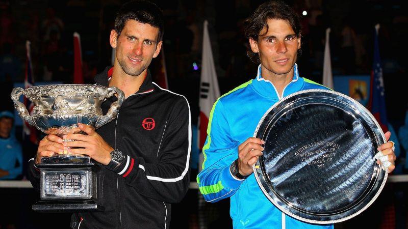 2012 Australian Open winner Novak Djokovic poses with Rafael Nadal