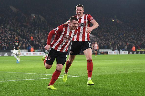 John Fleck celebrates his first-half goal