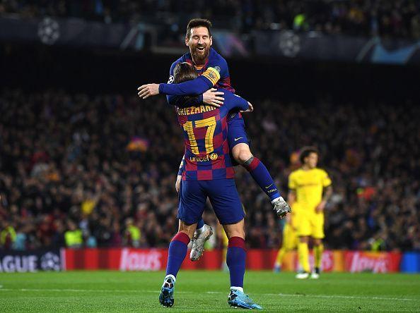 Lionel Messi celebrates with his teammate