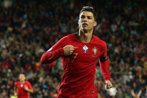 Ronaldo exults after scoring against Lithuania
