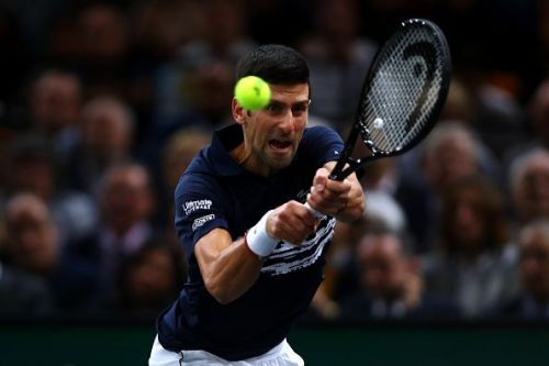 Novak Djokovic clinches a fifth title at the Paris Masters without dropping a set.