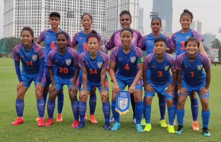 The Indian team pose before the game.