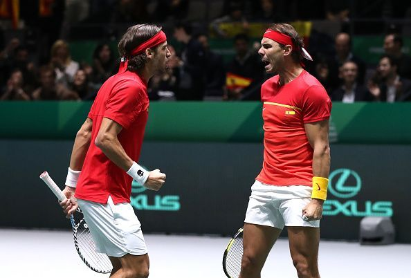 An ecstatic Felicano Lopez (left) with Rafael Nadal after guiding Spain into the Davis Cup finals