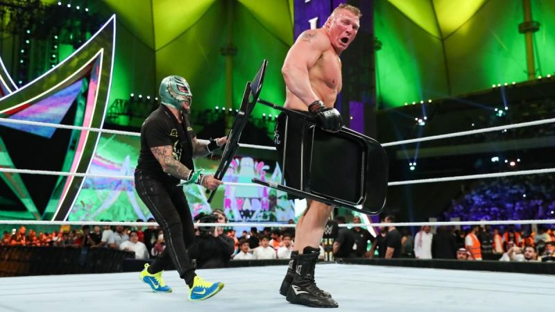 Rey Mysterio assaults Brock Lesnar