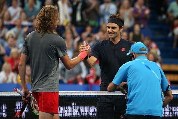 Stefanos Tsitsipas (L) and Roger Federer