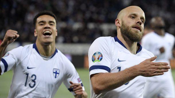 Teemu Pukki (right) rejoices after scoring a goal against Liechtenstein