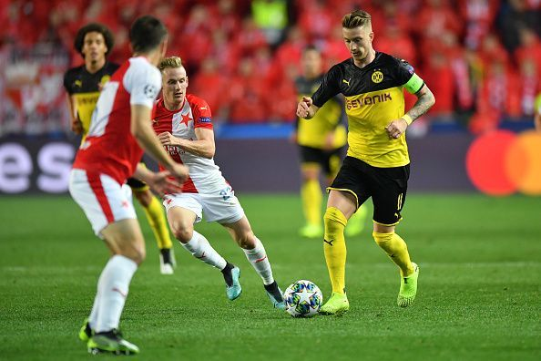 Reus, pictured here against Slavia Prague, has led by example with Dortmund this term