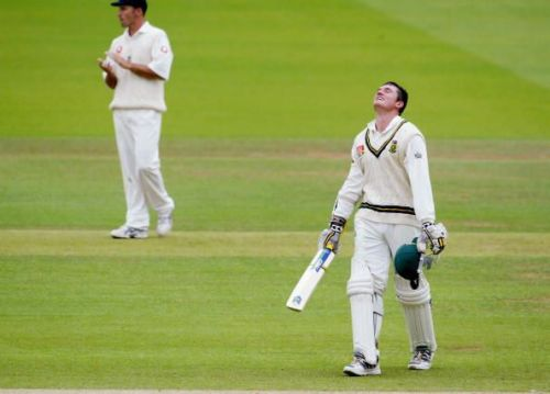 Graeme Smith of South Africa celebrates getting his double century as Nasser Hussain of England applauds