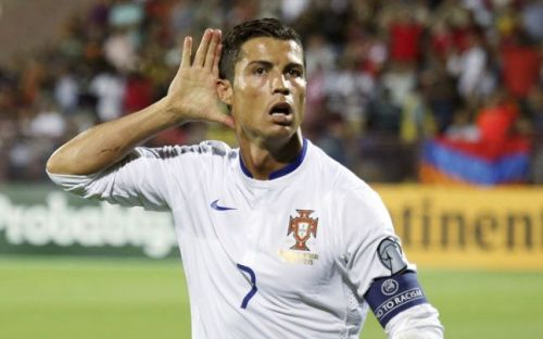 Ronaldo takes in the applause after scoring against Armenia