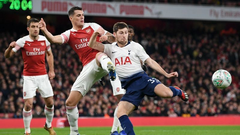 Ben Davies and Granit Xhaka during the north London derby