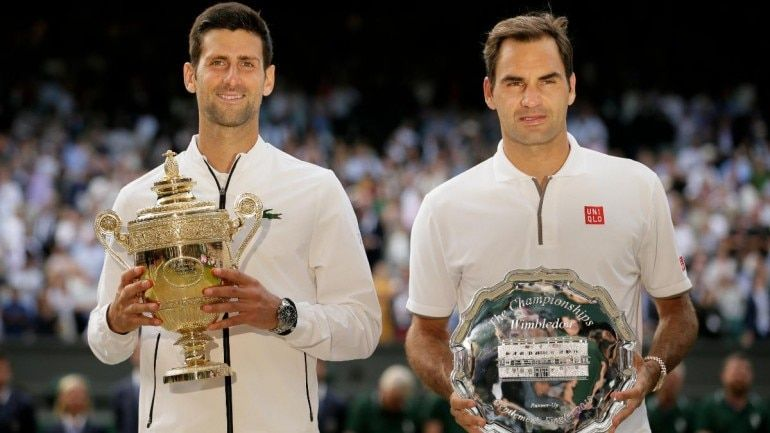 Novak Djokovic (L) and Roger Federer (R) after the 2019 Wimbledon final