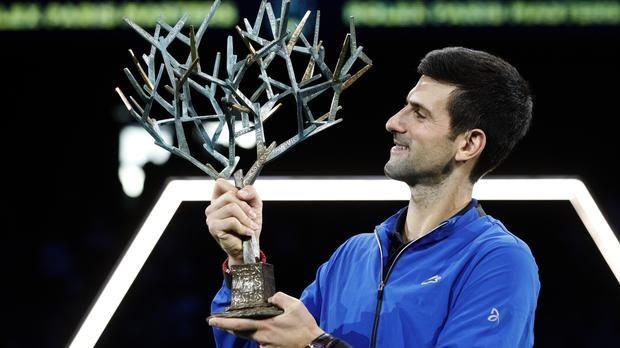 Novak Djokovic hoists aloft his record-extending 5th Paris Masters title